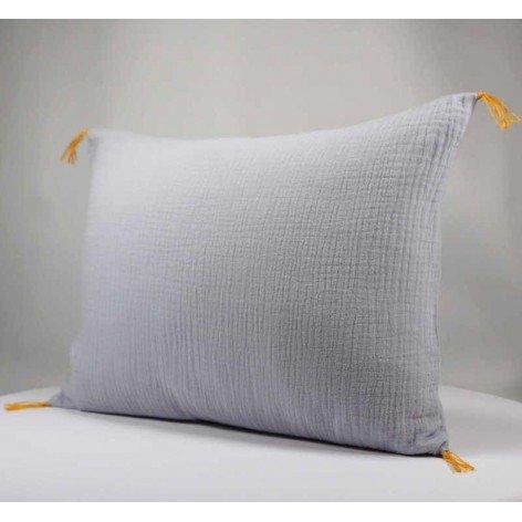 Coussin décoratif pompons gaze de coton